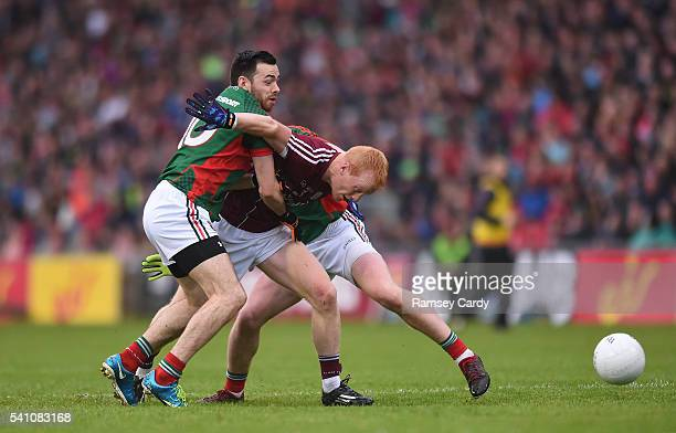 Castlebar , Ireland - 18 June 2016; Declan Kyne of Galway is tackled by Kevin McLoughlin, left, and Cillian OConnor of Mayo during the Connacht GAA...