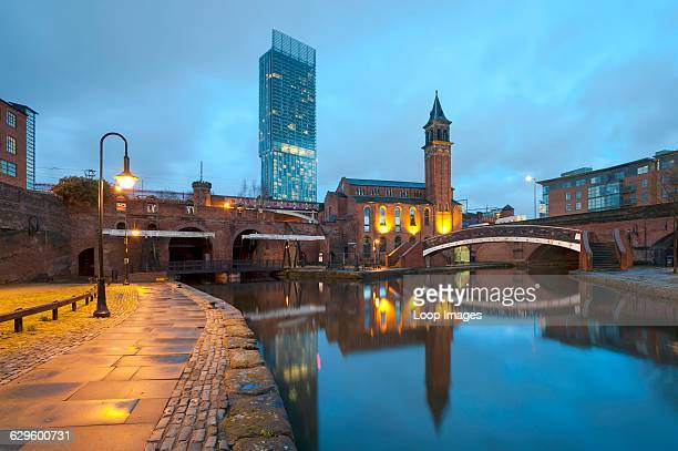 Castlefield and the Beetham Tower Hilton hotel at night, Castlefield, England.