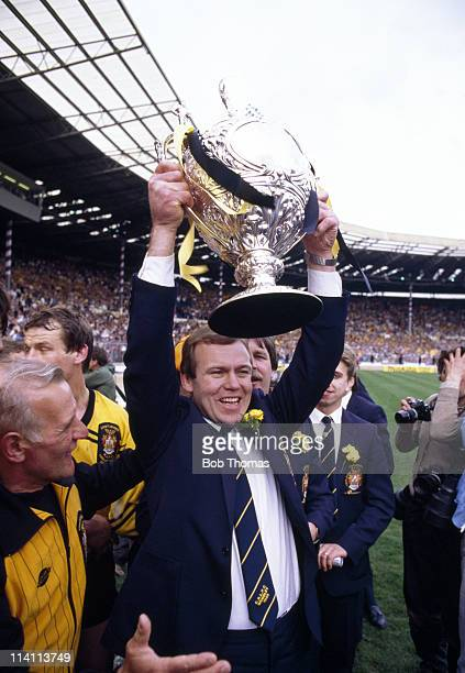 Castleford coach Mal Reilly holds aloft the trophy after beating Hull Kingston Rovers in the Silk Cut Challenge Cup Final at Wembley Stadium London...