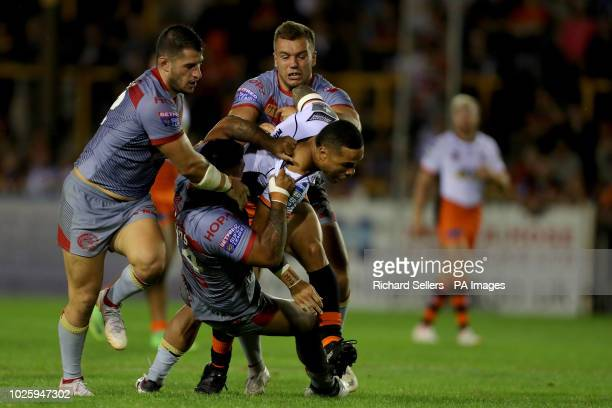 Castleford Tigers' Ben Roberts is tackled during the Betfred Super League match at the MendAHose Jungle Castleford