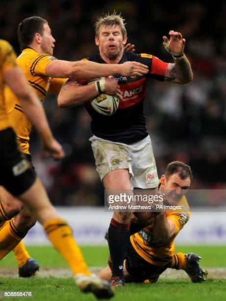 Castleford Tigers Danny Orr tackles Wakefield Trinity Wildcats' Glenn Morrison