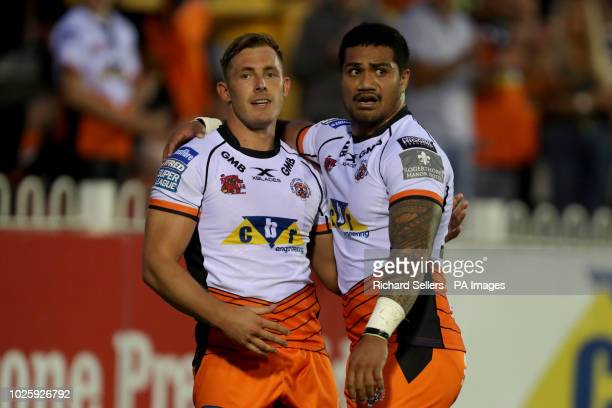 Castleford Tigers' Greg Eden is congratulated by Castleford Tigers' Peter Matautia after scoring during the Betfred Super League match at the...