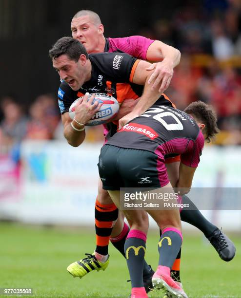 Castleford Tigers Joe Wardell is tackled by Hull KR's Joel Tomkins and Hull Kr's Matty Marsh during the Betfred Super League match at the MendAHose...