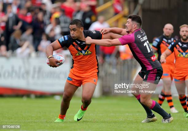 Castleford Tigers Junior Moors is tackled by Hull KR's Chris Clarkson during the Betfred Super League match at the MendAHose Jungle Casteford