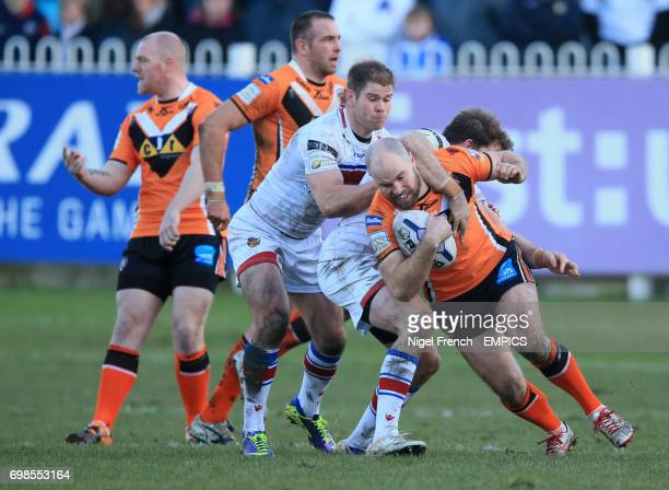 Castleford Tigers' Liam Finn is tackled by the Wakefield Wildcats