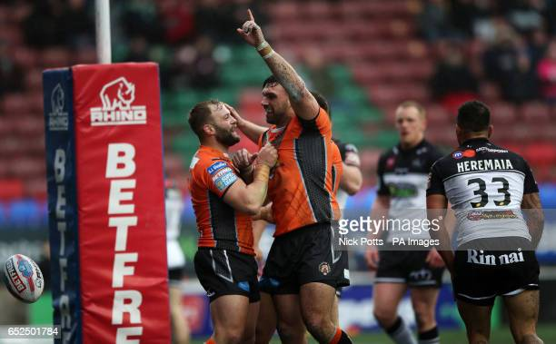 Castleford Tigers' Matt Cook celebrates scoring a try with Paul McShane during the Betfred Super League match at the Select Security Stadium Widnes