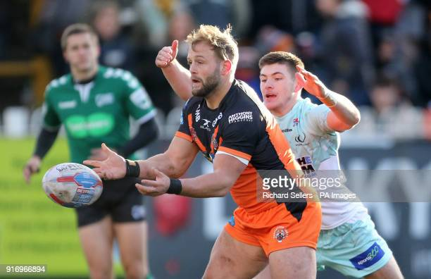 Castleford Tigers Paul McShane offloads as he's challenged by Widnes Vikings Tom Gilmore during the Betfred Super League match at the MendAHose...