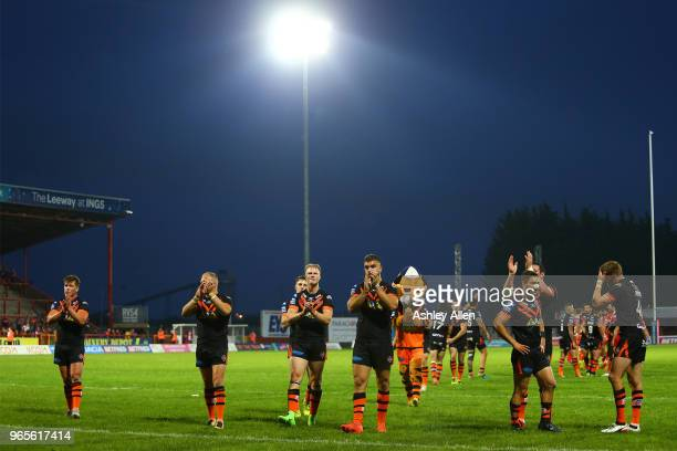 Castleford Tigers players celebrate during the Roger Millward Trophy match between Hull KR and Castleford Tigers as part of the Betfred Super League...