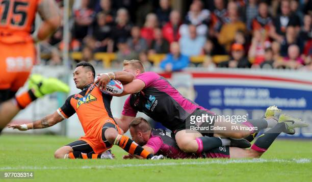Castleford Tigers Quentin LaulaTogaga'e is tackled during the Betfred Super League match at the MendAHose Jungle Casteford