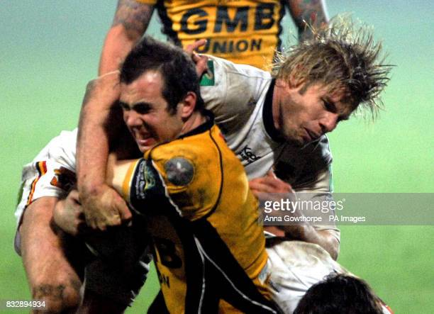 Castleford Tiger's Tommy Saxton is tackled by Bradford Bull's Glenn Morrison during the Carnegie Challenge Cup fourth round match at Odsal Stadium...