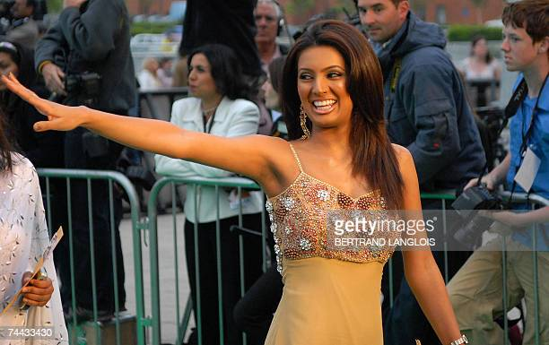 Indian actress Geeta Basra waves as she arrives at the World Premiere of the new film 'The Train' in Castleford northern England 07 June 2007 The...