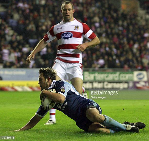 Castleford's Peter Lupton slides into score during the Wigan Warriors v Castleford Tigers Engage Super League match played at JJB Stadium on February...