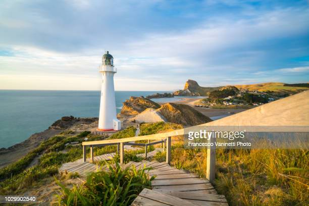 castlepoint lighthouse, new zealand. - wellington new zealand stock photos and pictures