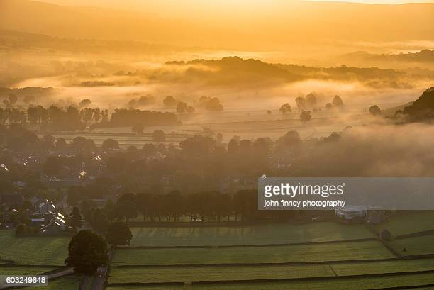 Castleton and hope valley misty sunrise landscape, English Peak District.