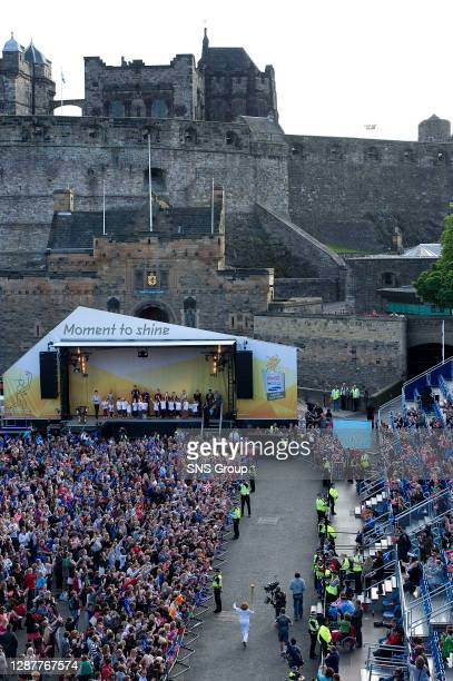 Torchbearer Lesley Forrest arrives at Edinburgh Castle on her to lighting the Olympic cauldron