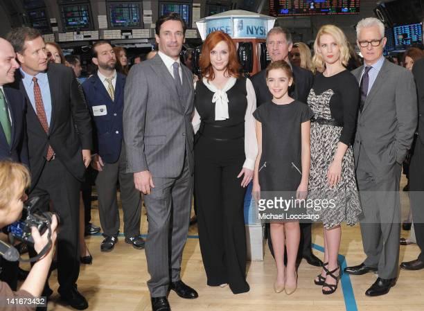 "Castmembers of ""Mad Men"" Jon Hamm, Christina Hendricks, Kiernan Shipka, January Jones and John Slattery pose after ringing the opening bell at the..."