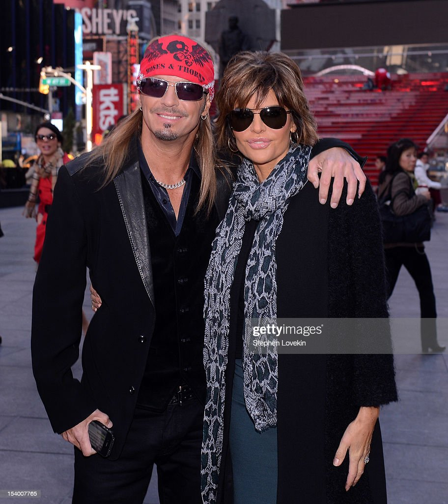 Castmembers singer/TV personality Brett Michaels and actress Lisa Rinna attend the 'Celebrity Apprentice All Stars' Season 13 Bus Tour at on October 12, 2012 in New York City.