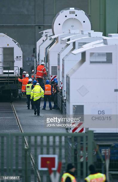 A Castor cask is moved from a train carriage into a truck container at a loading station in Dannenberg on November 28 before heading by road to the...
