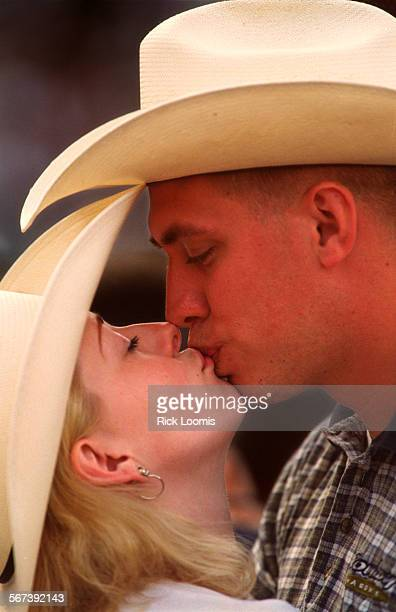 CAstraitkiss0426RL––Anaheim––Kerry Small and David Morrison also 23 both of San Bernardino kiss during the country music festival Saturday night...