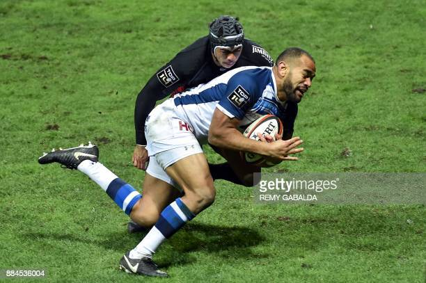 TOPSHOT Castres' Afusipa Taumoepeau is about to score a try during the French Top 14 rugby union match between Toulouse and Castres at the Ernest...
