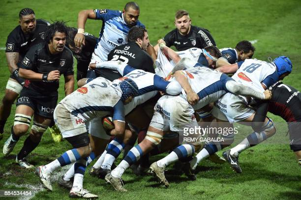 Castres' and Toulouse's players are pictured during the French Top 14 rugby union match between Toulouse and Castres at the Ernest Wallon Stadium in...