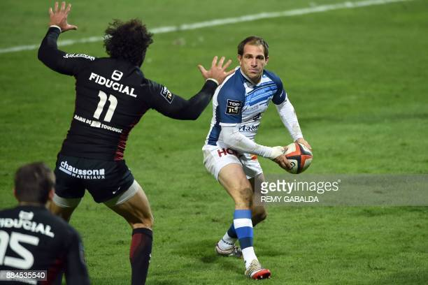 Castres' flyhalf Ben Urdapilleta passes the ball during the French Top 14 rugby union match between Toulouse and Castres at the Ernest Wallon Stadium...