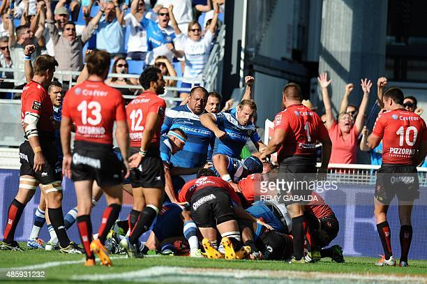Castres' forwards score the first try during the French Top 14 rugby union match Castres vs Toulon on August 30 2015 at Pierre Antoine Stadium in...