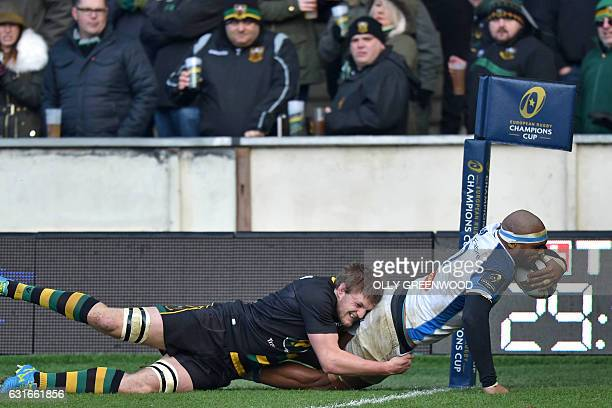 Castres French flanker Alexandre Bias dives over the line to score their first try during the European Rugby Champions Cup rugby union match between...