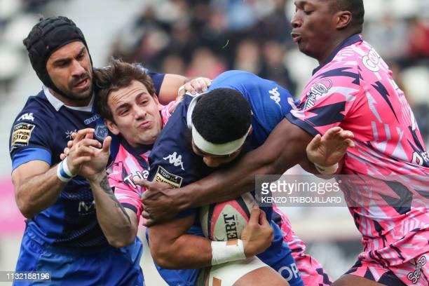 Castres French flanker Ma'ama Vaipulu vies for the ball with Stade Francais' French flanker Sekou Macalou during the French Top 14 rugby union match...