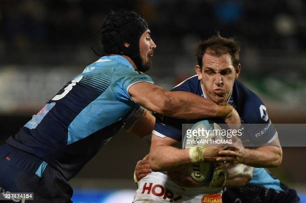 Castres French flyhalf Benjamin Urdapilleta is tackled by Montpellier's French number eight Alexandre Dumoulin during the French Top 14 rugby union...