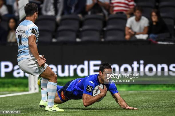TOPSHOT Castres' French full back Geoffrey Palis scores a try during the French Top 14 rugby union match between Racing 92 and Castres on September 1...