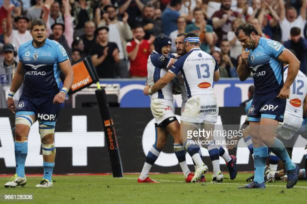 Castres' French fullback Julien Dumora celebrates with teammates after scoring a try during the French Top 14 final rugby union match between...