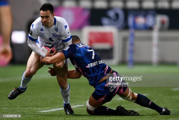 Castres' French right wing Geoffrey Palis fights for the ball with Stade Francais' French flanker Ryan Chapuis during the French Top 14 rugby union...