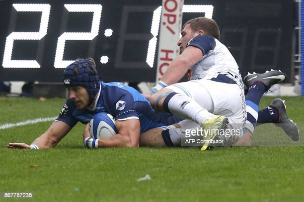 Castres' French winger Armand Batlle scores a try during the French Top 14 rugby union match between Castres and Agen at the Pierre Fabre Stadium in...
