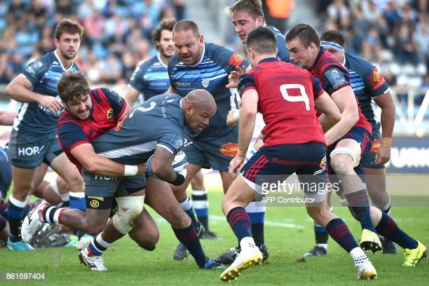 TOPSHOT Castres' hooker Jody Jenneker is tackled by Munster's players during this Champions Cup rugby Union match between Castres Olympique Rugby and...