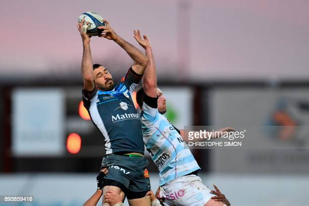 Castres Olympique's French flanker Yannick Caballero grabs the ball in a line out during the European Rugby Champions Cup rugby union match between...