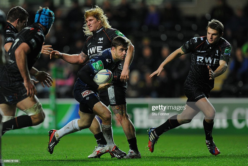 Castres player Rory Kockott makes a break during the Heineken Cup pool 1 round 4 match between Ospreys and Castres Olympique at Liberty Stadium on December 13, 2013 in Swansea, Wales.