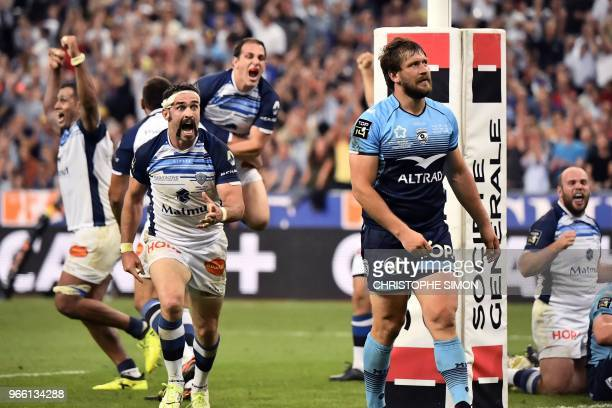Castres' players celebrate a try during the French Top 14 final rugby union match between Montpellier and Castres at the Stade de France in...