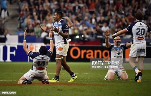 Castres' players celebrate after winning the French Top 14 final rugby union match between Montpellier and Castres at the Stade de France in...