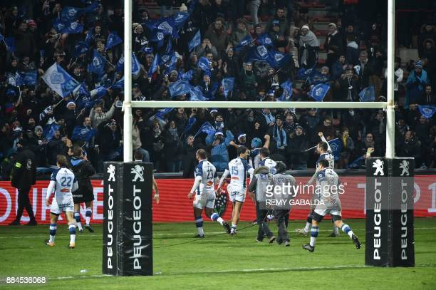 Castres' players celebrate after winning the French Top 14 rugby union match between Toulouse and Castres at the Ernest Wallon Stadium in Toulouse...