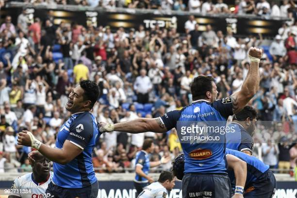 Castres' players react after winning the French Top 14 rugby union semifinal match between Racing 92 and Castres Olympique on May 26 2018 at the...