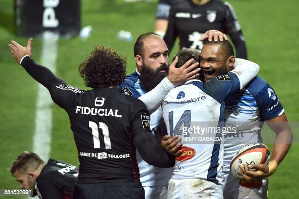 Castres' s flanker Alexandre Bias celebrates after scoring a try during the French Top 14 rugby union match between Toulouse and Castres at the...
