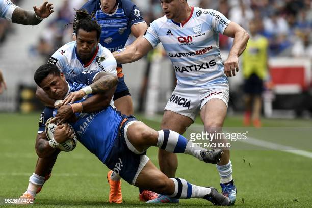 Castres' Samoan winger David Smith is tackld by Racing 92's French winger Teddy Thomas during the French Top 14 rugby union semifinal match between...