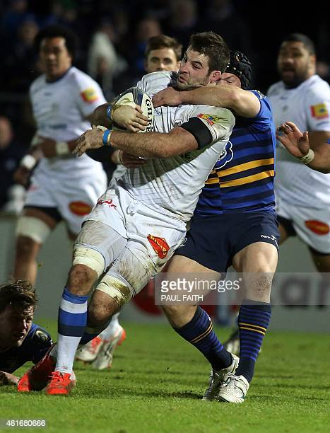 Castres' Scottish number 8 Johnnie Beattie is tackled during the European Rugby Champions Cup rugby union match between Leinster and Castres...