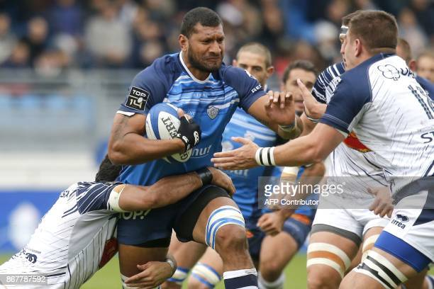 Castres' Tongan lock Steve Mafi runs with the ball during the French Top 14 rugby union match between Castres and Agen at the Pierre Fabre Stadium in...