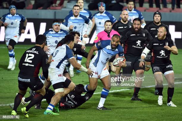 Castres's centre Afusipa Taumoepeau runs with the ball during the French Top 14 rugby union match between Toulouse and Castres at the Ernest Wallon...