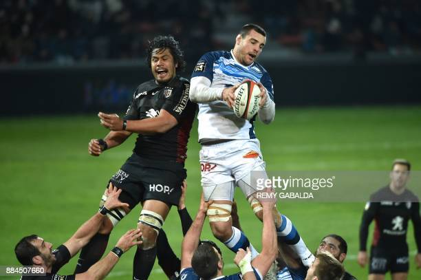 Castres's lock Loic Jacquet grabs the ball in a line out during the French Top 14 rugby union match between Toulouse and Castres at the Ernest Wallon...