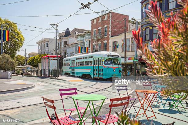 castro streetcar with rainbow flags in the streets of san francisco - san francisco california stock photos and pictures