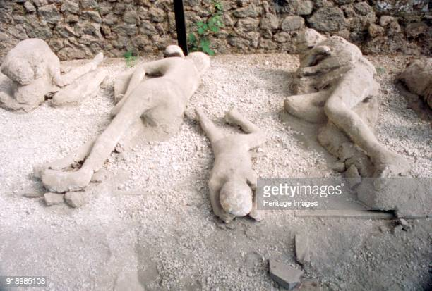 Casts of victims of eruption of Vesuvius in AD79 Pompeii Italy c20th century Artist Unknown