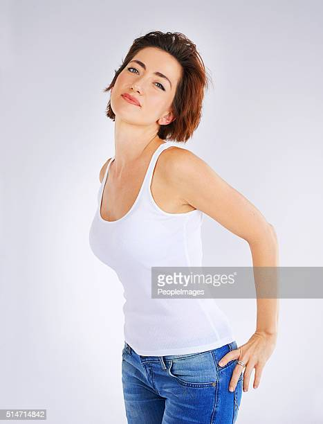 casual and confident - arms akimbo stock pictures, royalty-free photos & images